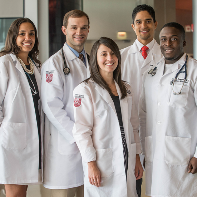 Five physicians posing for a photo